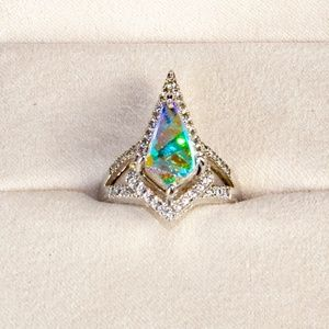 Amazing opalescent ring in a very unique shape
